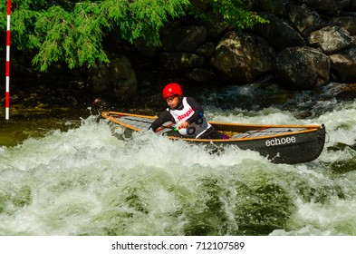 Minden, Ontario - September 9, 2017: Unidentified paddler in a open canoe equipped with air bags applies a low brace  in the powerful rapids on Gull River in Minden
