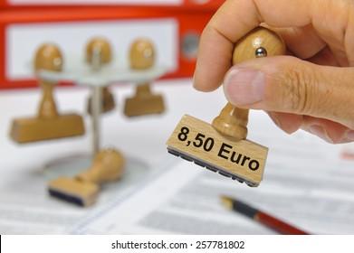 Mindestlohn 8,50 Euros printed on rubber rubber stamp - minimum wage 8,50 Euro