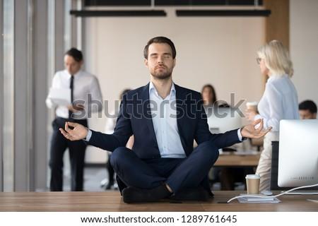 Mindful calm businessman in