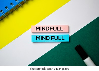 Mindfull or Mind Full text on sticky notes with office desk concept