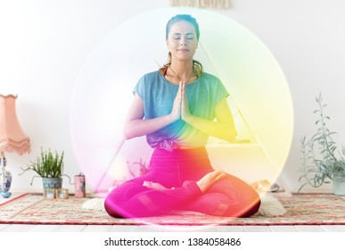 mindfulness, spirituality and healthy lifestyle concept - woman meditating in lotus pose at yoga studio over rainbow aura