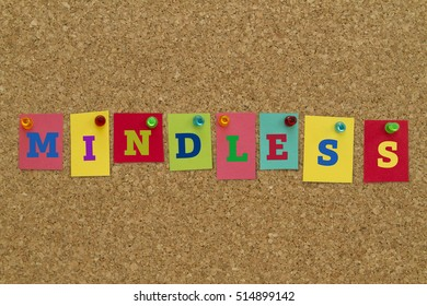 Mindless word written on colorful sticky notes pinned on cork board.