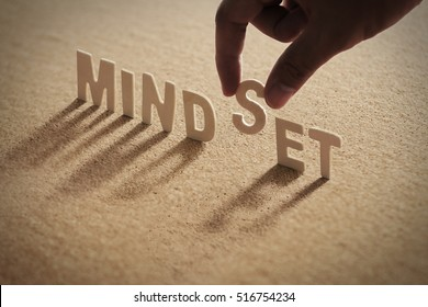 MINDSET word of wood alphabet with shadow on cork board,compressed board