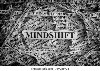 Mindshift. Torn pieces of paper with word Mindshift. Concept Image. Black and White. Closeup.