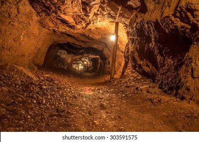 Mine Shaft. Interior of a mining shaft with diminishing perspective and copy space.