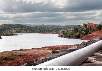 Mine tailings reservoir in Magadascar, receiving slurry through a pipeline from an ore processing plant.