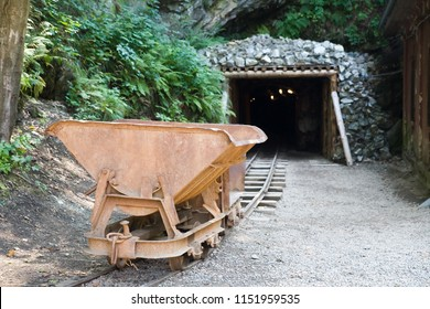 mine trolley standing in front of the old gold mine