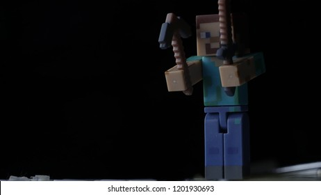 Minecraft figure closeup with black background.
