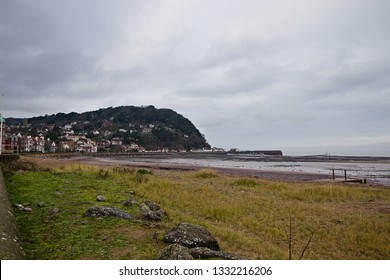 Minehead is a coastal town in Somerset, England, on the south bank of the Bristol Channel and experiences one of the highest tidal ranges in the world. Here the beach is visible during the low tide
