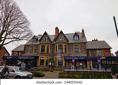 """Minehead, Somerset, England - December 23, 2018: Hairy Dog is a typical english pub and restaurant on the central street """"The Avenue"""" of Minehead"""