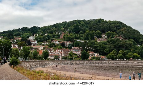 Minehead, UK - July 27, 2016: View of Minehead Somerset England UK beach and seafront towards the harbour and view of the North Hill mountain.