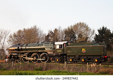 MINEHEAD, UK - MARCH 24: Ex BR Pacific steam loco Britannia prepares to move into Minehead station to pick up a rake of coaches during the WSR spring steam gala on March 24, 2012 in Minehead