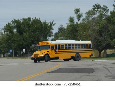 MINEOLA, TEXAS—SEPTEMBER 2017: A public school bus runs along the highway in Mineola, Texas to pick up students from school.
