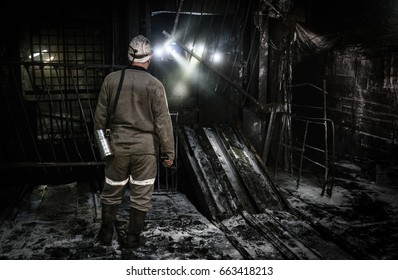 Miner in a coal mine. Mining