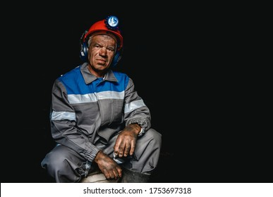 Miner happy man smiling after working on coal mine. Concept industrial engineer.