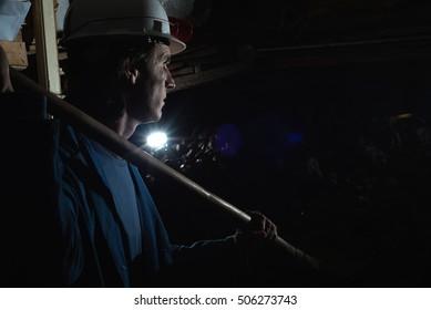 Miner shoveling ore