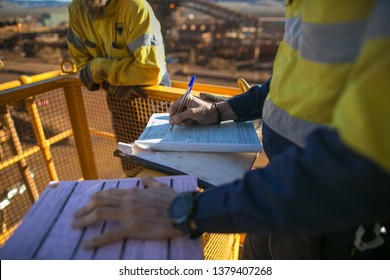 Miner supervisor sign of approval working at height working permit prior to performing high risk work on construction mine site, Perth, Australia
