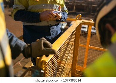 Miner worker looking at personnel risk assessment take five book at construction mine site Perth, Australia