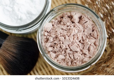 Mineral homemade powder foundation or dry shampoo in a grass jar. DIY cosmetics. Top view, close up, copy space.