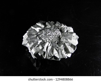 Mineral pyrite, or iron pyrite, is also known as the fool's gold. On a black background