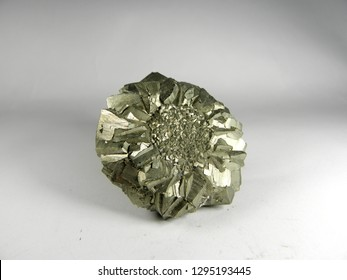 Mineral pyrite, or iron pyrite, is also known as the fool's gold. On a white background