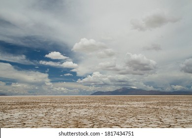 Mineral resources. View of the salt desert texture, mountains and beautiful cloudy blue sky.