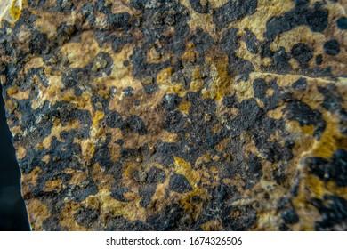 Mineral rock surface background, flat light, natural vanadinite pattern