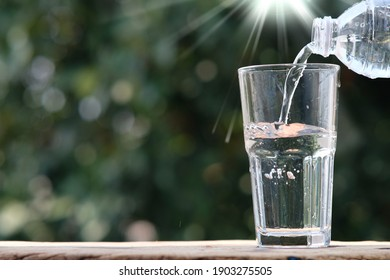 Mineral water on wood table and space for text