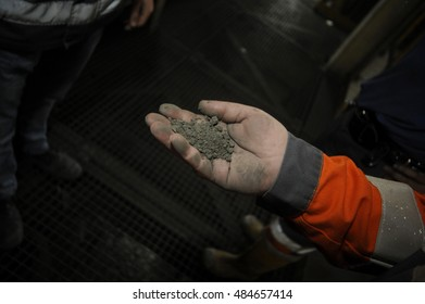 Miners hand holding a raw material