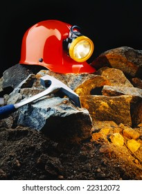Miner's helmet with pick axe and rocks