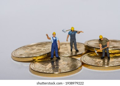 miners working on gold shining bitcoins crypto currency with gray background