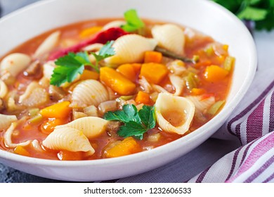 Minestrone, italian vegetable soup with pasta on  table. Vegan food