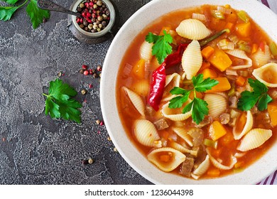 Minestrone, italian vegetable soup with pasta on  table. Vegan food. Top view