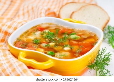 Minestrone with tomatoes, green peas and pepper.