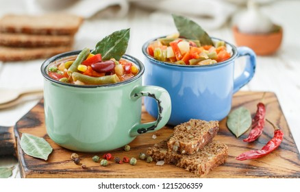 Minestrone - traditional Italian thick vegetable soup with seasonal vegetables-potatoes, carrots, onions, red and green beans, corn, peas, tomatoes with seasonings and spices with pasta or rice