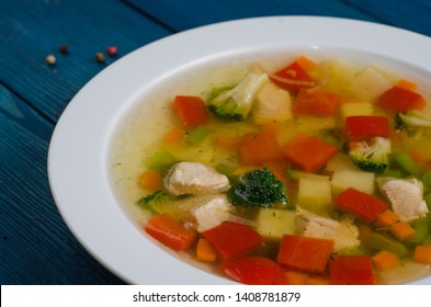 minestrone vegetable soup plate on blue wood background