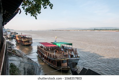 Mingun, Mandalay, Myanmar - nov 2012 : tourist boats moored on the banks of the Irrawaddy River near the Mingun temples, just a few kilometers from Mandalay.