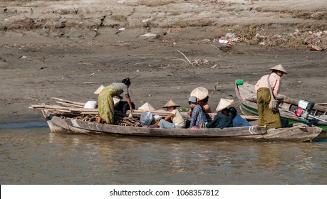 Mingun, Mandalay, Myanmar - nov 2012 :   on the Irrawaddy River near Mandalay a Burmese family loaded their boat with firewood and returned home