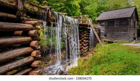 Mingus Mill at the smoky mountains national park with lush spring green and flowing water