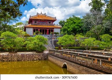 Minh Lau pavilion and Trung Dao bridge at Minh Mang Emperor Tomb in Hue, Vietnam