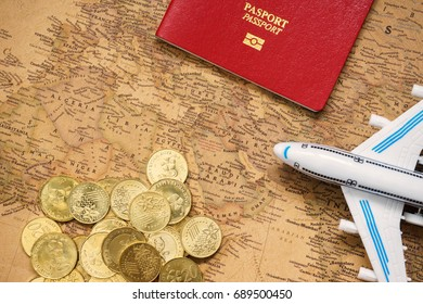 Mini airplane, passport, gold coins and a map of Saudi Arabia. Close up. Travel concept.