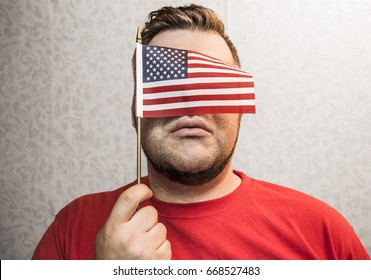 mini American flag covered face, adult man holding isolated on white wallpaper wall  background, 4 th of July, no face, eyes. unrecognizable person