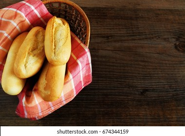 Mini baguettes on a wooden table