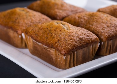Mini Banana Loafs on a white tray showing close up view