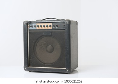 mini bass music amplified on white background