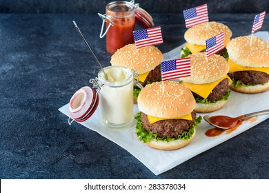 Mini beef cheeseburgers with American flags on top,selective focus
