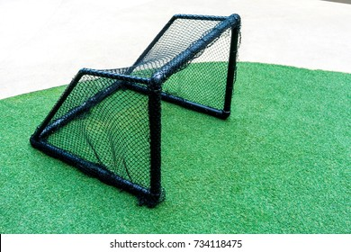 Mini black soccer or football goal on an artificial grass