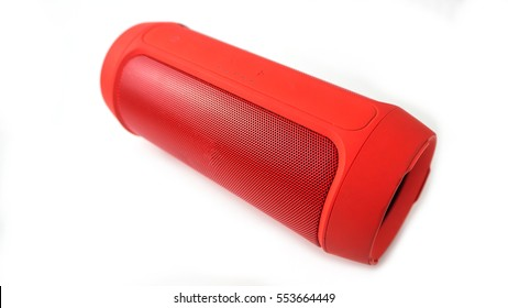 Mini bluetooth red speaker isolated on over white background.