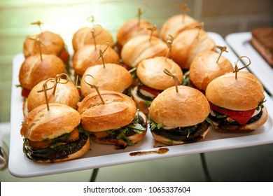 mini burger canape selection on slate platter, event catering