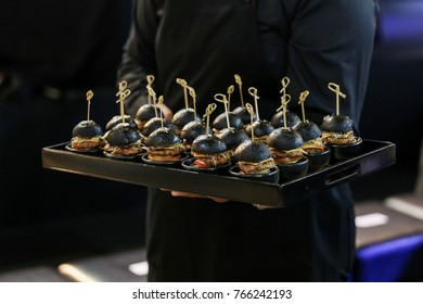 mini burger canape selection on slate platter ready to served.